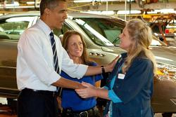 President Barack Obama drives a 2011 Chevrolet Volt off the line with Plant Manager Teri Quigley, GM Detroit-Hamtramck Assembly Plant, Michigan, 30.07.2010